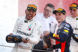 Lewis Hamilton, Mercedes AMG F1, and Max Verstappen, Red Bull Racing celebrate on the podium by spraying champagne