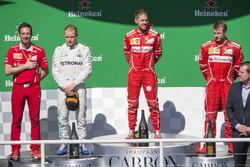 Podio: il vincitore Sebastian Vettel, Ferrari, il secondo classificato Valtteri Bottas, Mercedes AMG F1, il terzo classificato Kimi Raikkonen, Ferrari, Giuseppe Vietina, Ferrari