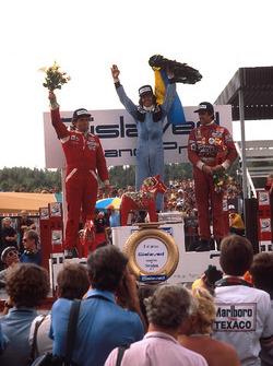 Podium: race winner Jacques Laffite, Ligier, second place Jochen Mass, McLaren, third place Carlos Reutemann, Ferrari
