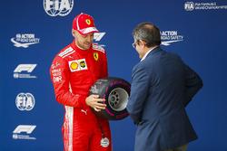 Sebastian Vettel, Ferrari, accepts his Pole Position award