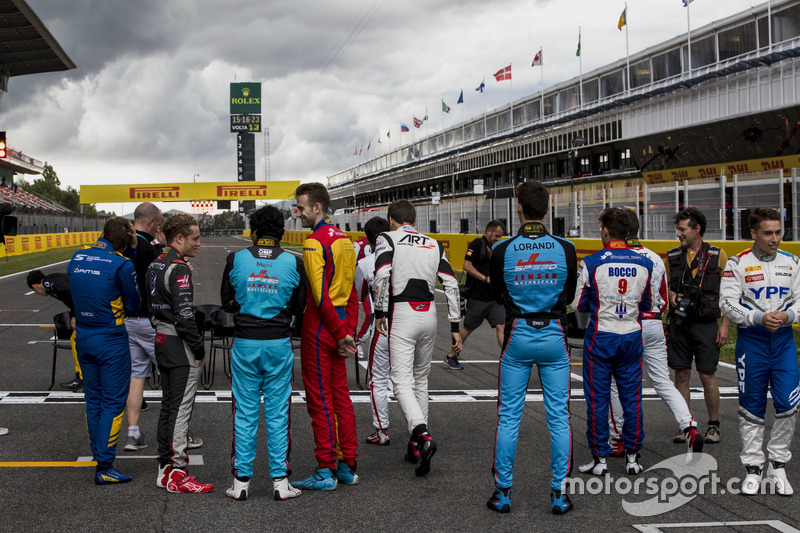 Drivers wait for the class photo