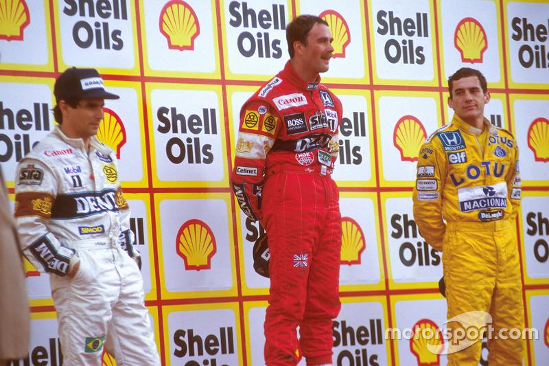 Podium : le vainqueur Nigel Mansell, Williams, le second Nelson Piquet, Williams, le troisième Ayrton Senna, Team Lotus
