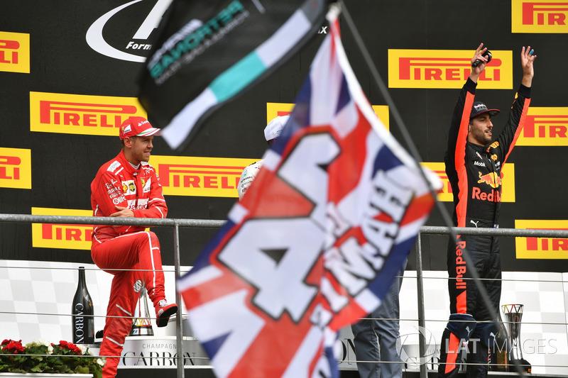 Sebastian Vettel, Ferrari and Daniel Ricciardo, Red Bull Racing, celebrate on the podium