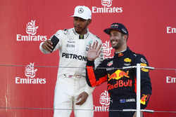 Race winner Third place Lewis Hamilton, Mercedes AMG F1 Daniel Ricciardo, Red Bull Racing, take a photo on the podium