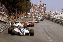Riccardo Patrese, Brabham BT49D Ford leads Alain Prost, Renault RE30B, Didier Pironi, Ferrari 126C2 and Andre de Cesaris, Allfa Romeo 182
