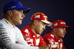 Обладатель поула Себастьян Феттель, второе место – Кими Райкконен, Ferrari, третье место – Валттери Боттас, Mercedes AMG F1