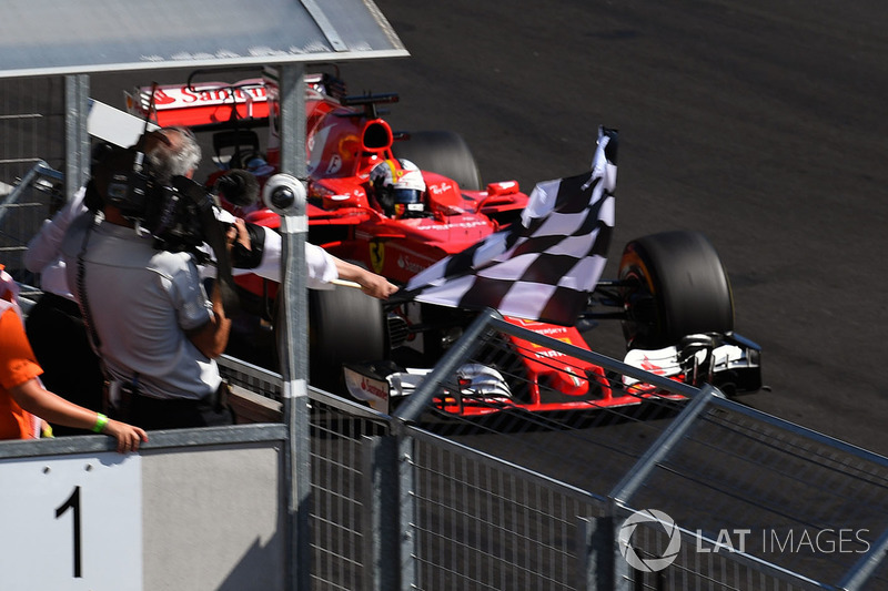 Race winner Sebastian Vettel, Ferrari SF70-H takes the chequered flag