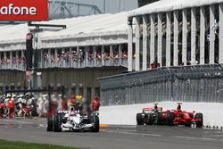 Robert Kubica, BMW Sauber F1.08 passes Lewis Hamilton, McLaren Mercedes MP4/23 and the Kimi Raikkonen, Ferrari  F2008
