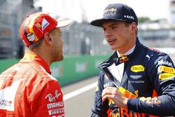 Pole winner Sebastian Vettel, Ferrari, talks to second place Max Verstappen, Red Bull Racing