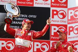1. Felipe Massa, Ferrari; 3. Michael Schumacher, Ferrari
