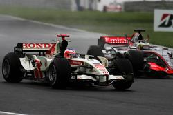 Rubens Barrichello, Honda RA106 with Pedro de la Rosa, McLaren Mercedes MP4/21