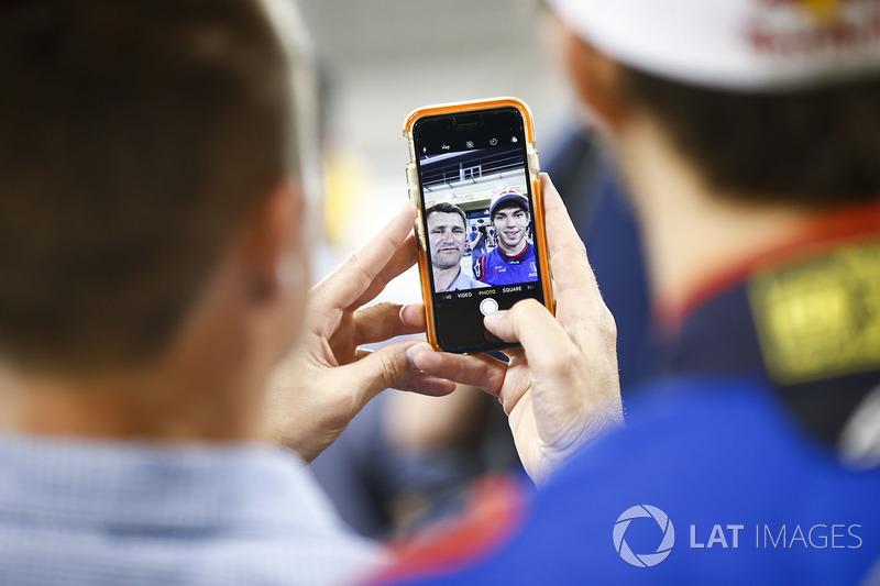 Pierre Gasly, Toro Rosso, takes a selfie with a fan