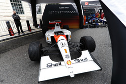 A 1991 McLaren Honda MP4/6 under an awning ahead of the London Formula 1 street parade