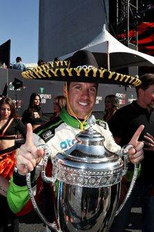 Winner Benito Guerra, celebrates on the podium