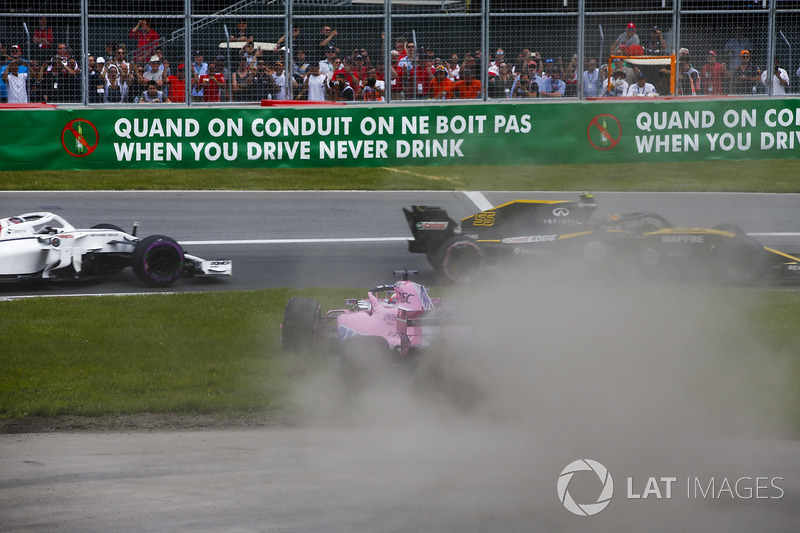 A sideways Sergio Perez, Force India VJM11, bounces over the grass after battling with Carlos Sainz