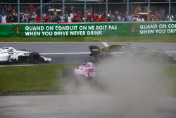 A sideways Sergio Perez, Force India VJM11, bounces over the grass after battling with Carlos Sainz Jr., Renault Sport F1 Team R.S. 18