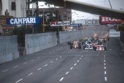 Gerhard Berger, Mclaren MP4/5B Honda leads Jean Alesi, Tyrrell 018 Ford, Andrea de Cesaris, Dallara 190 Ford, Ayrton Senna, Mclaren MP4/5B Honda and Pierluigi Martini, Minardi M189 Ford at the start