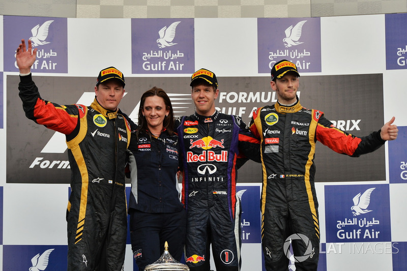 Podium: tweede Kimi Raikkonen, Lotus F1 Team, Gill Jones, Red Bull Racing, winnaar Sebastian Vettel,