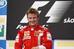 Kimi Raikkonen, Ferrari F2007, celebrates victory on the podium