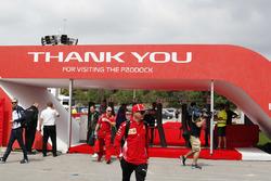 Kimi Raikkonen, Ferrari, and Robert Kubica, Williams Martini Racing, arrive in the paddock