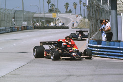 Mario Andretti, Lotus 78 Ford gives teammate Gunnar Nilsson a lift back
