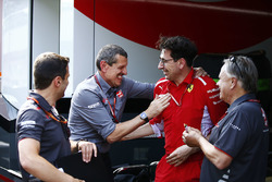 Guenther Steiner, Team Principal, Haas F1, is congratlated by a Gene Haas, Team Owner, Haas F1, and Mattia Binotto, Ferrari Chief Technical Officer