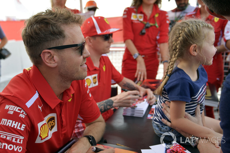 Sebastian Vettel, Ferrari and Kimi Raikkonen, Ferrari at the autograph session