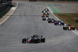 Kevin Magnussen, Haas F1 Team VF-18, leads Fernando Alonso, McLaren MCL33, Pierre Gasly, Toro Rosso STR13, and Romain Grosjean, Haas F1 Team VF-18