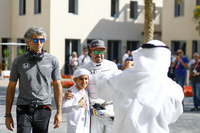Fernando Alonso, McLaren, with a young fan