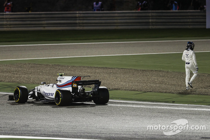 Lance Stroll, Williams FW40, climbs out of his car and walks away after a collision with Carlos Sain
