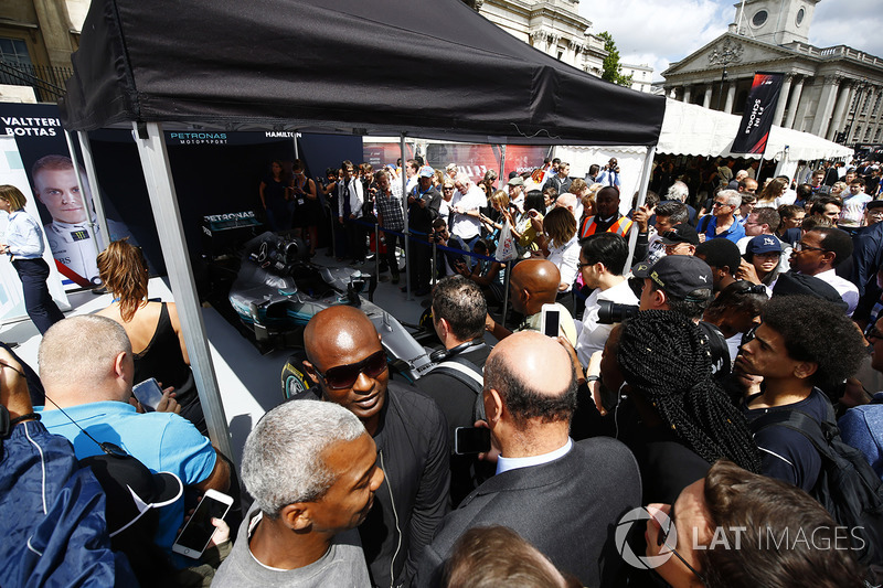 Fans gather around the Mercedes AMG F1 W08 on the teams stand