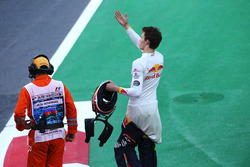 Daniil Kvyat, Scuderia Toro Rosso, waves to fans in the crowd after retiring from the race