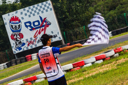 Marshal waves chequered flag