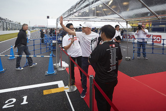 Valtteri Bottas, Mercedes AMG F1, waves to the fans