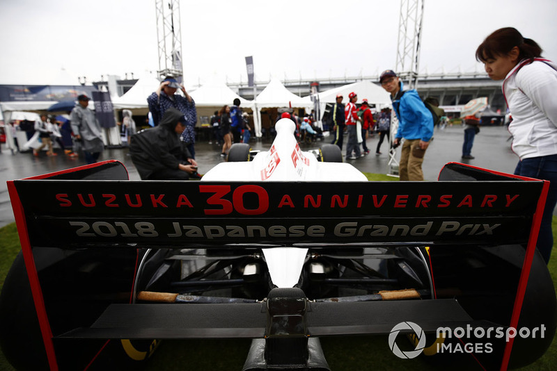 Fans admire a specially liveried 30th anniversary car