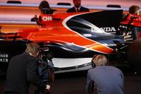 Media gather around the McLaren MCL32