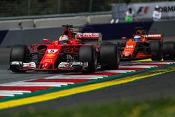 Sebastian Vettel, Ferrari SF70H and Fernando Alonso, McLaren MCL32