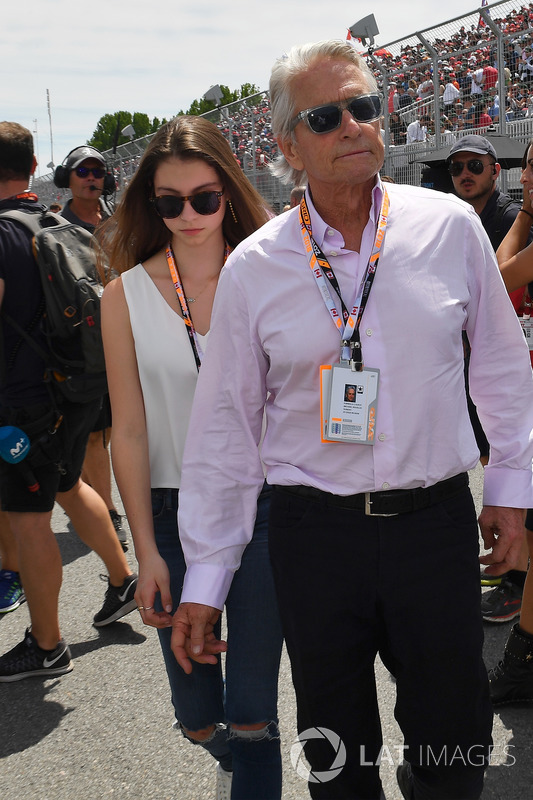 Michael Douglas, with his son Dylan Douglas, and daughter Carys Zeta-Douglas, on the grid