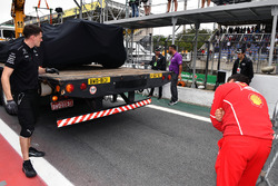 The crashed car of Lewis Hamilton, Mercedes-Benz F1 W08  is returned to the pits after his Q1 crash