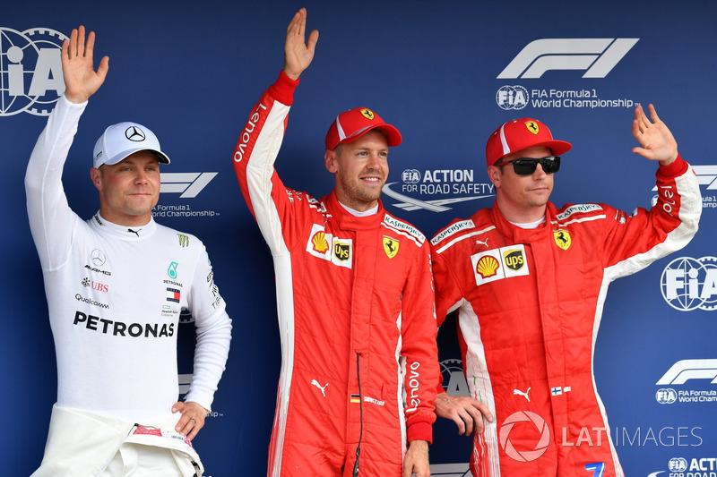 Valtteri Bottas, Mercedes-AMG F1, pole sitter Sebastian Vettel, Ferrari and Kimi Raikkonen, Ferrari celebrate in parc ferme