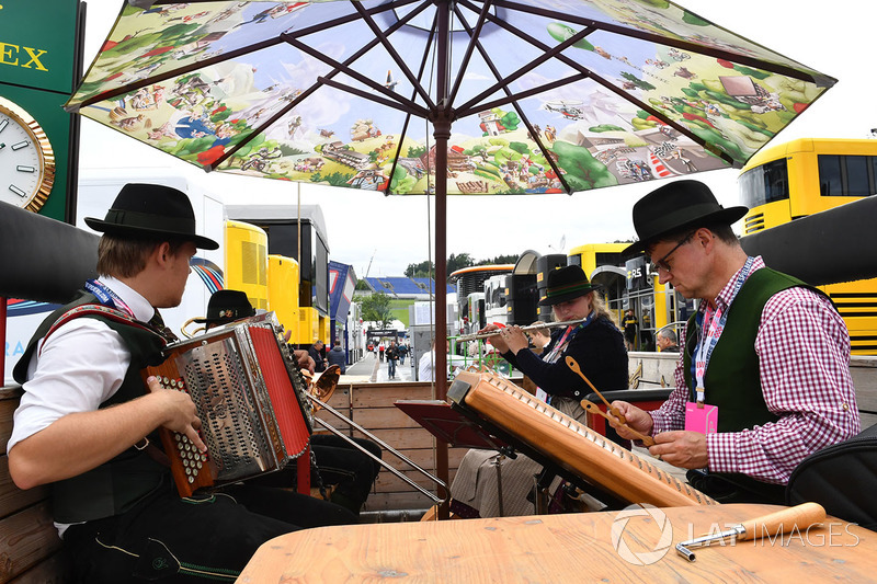 Musicians play in the paddock