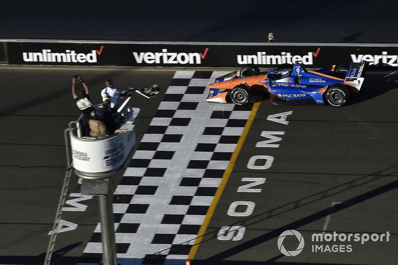 Scott Dixon, Chip Ganassi Racing Honda crosses the finish line under the checkered flag for the championship win