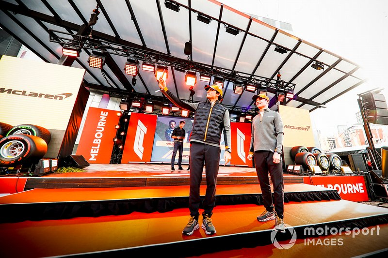 Carlos Sainz Jr., McLaren and Lando Norris, McLaren take a selfie on stage at the Federation Square event