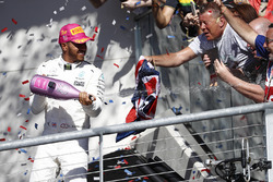 Race winner Lewis Hamilton, Mercedes AMG F1, sprays the victory Champagne