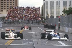 Jean Alesi Tyrrell 018 Ford laps Michele Alboreto, Arrows A11B Ford with Ayrton Senna, Mclaren MP4/5B Honda on his heels behind