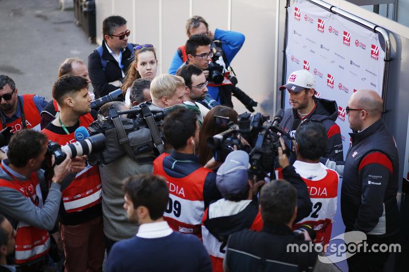 Romain Grosjean, Haas F1 Team, surrounded by a media scrum