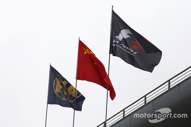 The FIA, Chinese and Formula 1 flags on display