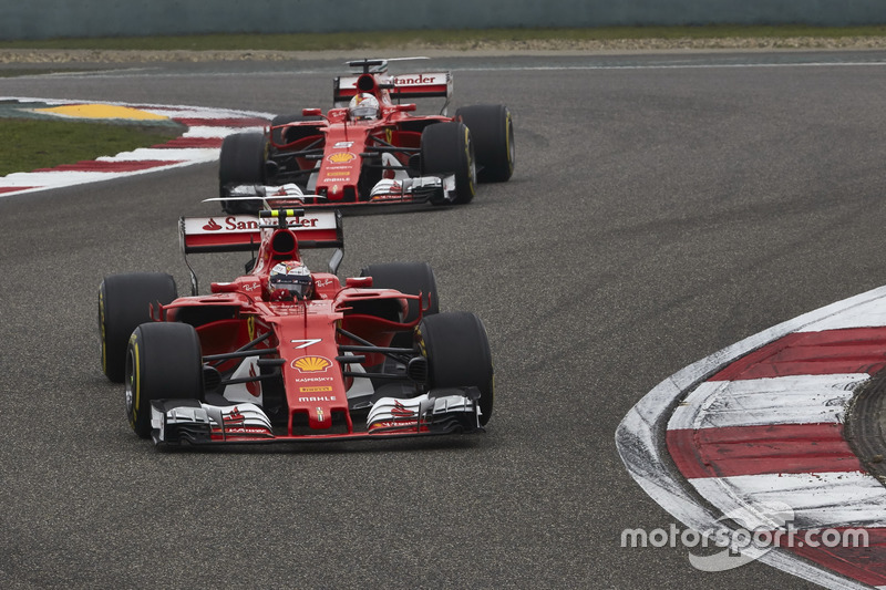 Kimi Raikkonen, Ferrari SF70H, leads Sebastian Vettel, Ferrari SF70H