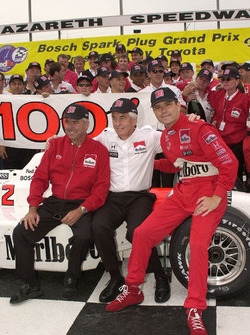 Rick Mears, Roger Penske, and Gil de Ferran celebrate Team Penske 100th IndyCar victory