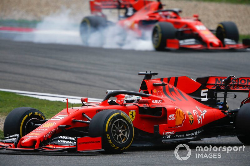 Sebastian Vettel, Ferrari SF90, leads Charles Leclerc, Ferrari SF90, as he locks up